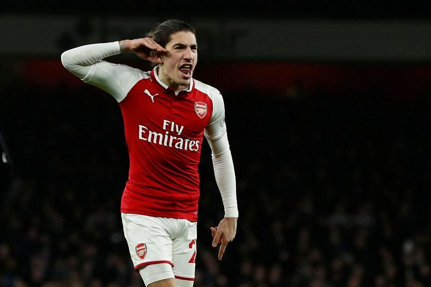 Arsenal's Hector Bellerin celebrates scoring their second goal.