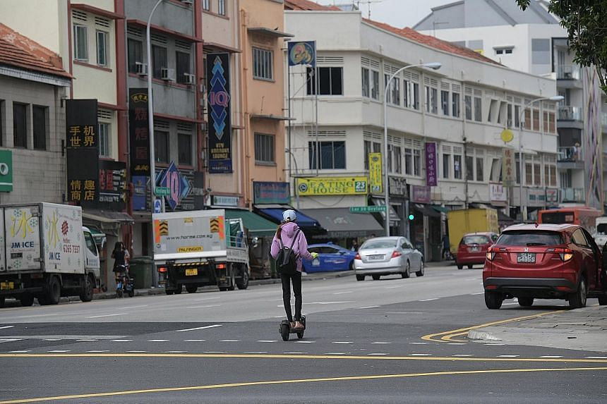 Personal mobility device users were seen travelling alongside cars, vans and pickups in Geylang yesterday at around noon. Within an hour, The Straits Times team spotted six riders along Geylang Road and Sims Avenue. One rider even zipped across the f