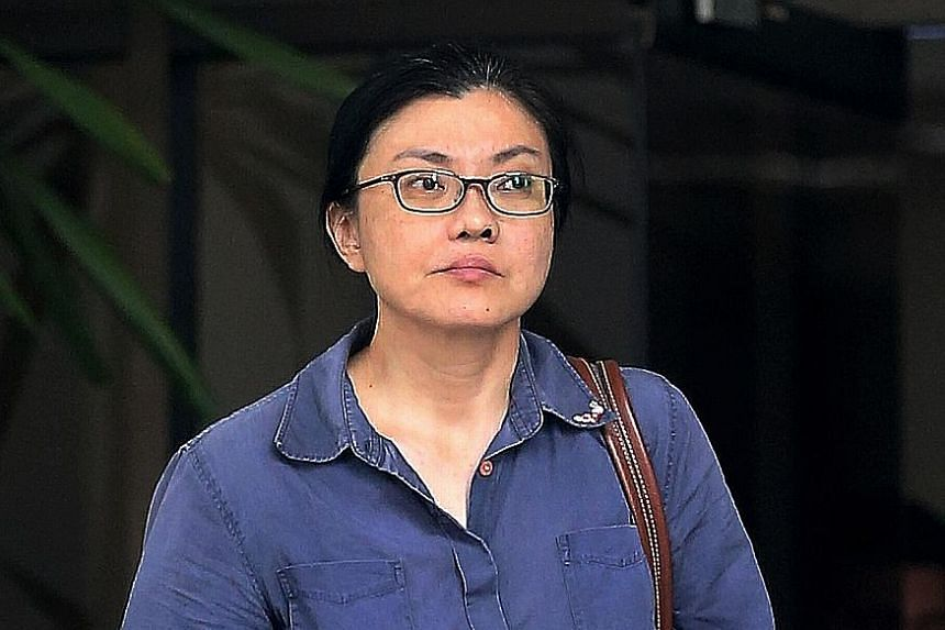 Koh Sock Buay was jailed 14 weeks for dishonestly misappropriating $26,822 and trying to bite a police officer's hand.
