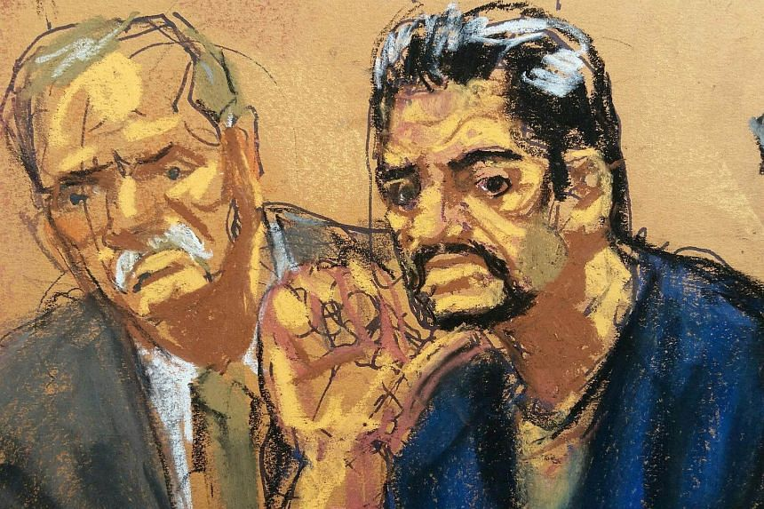 Mehmet Hakan Atilla (right) sits with lawyer Victor Rocco as he appears in Manhattan federal court in New York, on April 24, 2017.