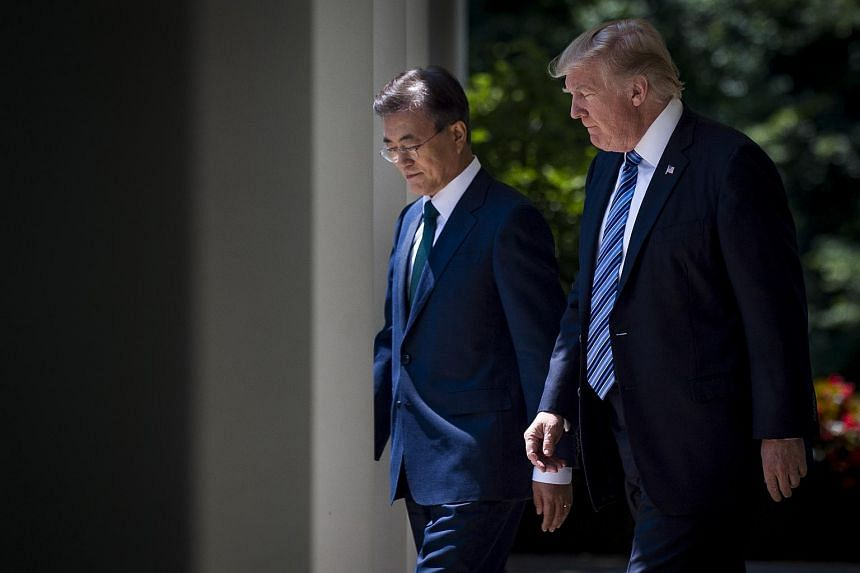 US President Donald Trump and South Korean President Moon Jae In walking to the Rose Garden to deliver joint statements at the White House in Washington on June 30, 2017.