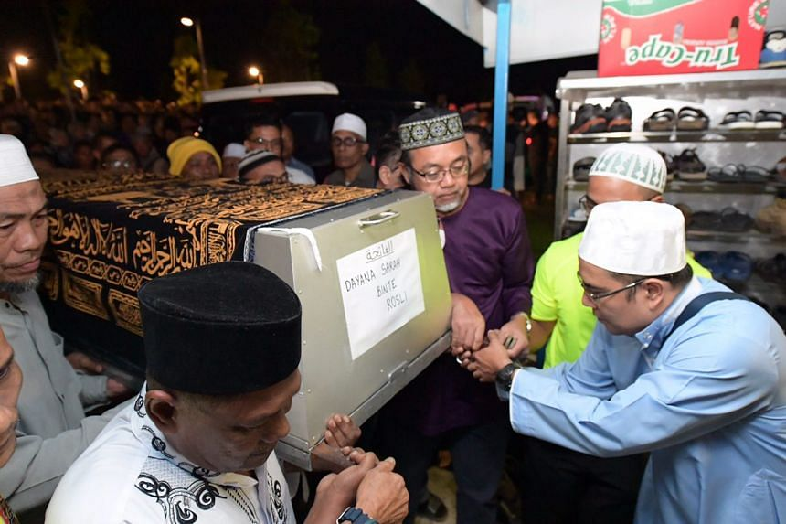 The casket for Dayana Sarah Rosli, 18, arrives at the Muslim cemetery in Choa Chu Kang.