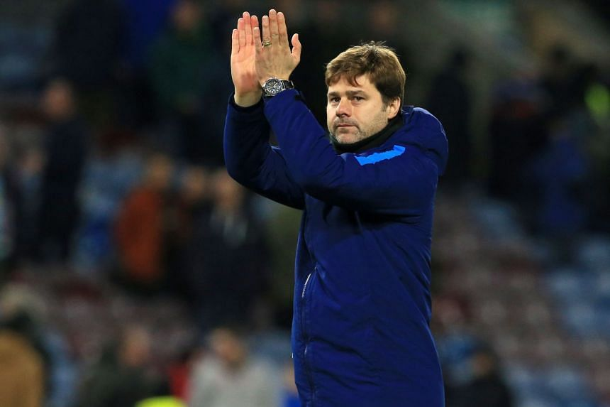 Tottenham Hotspur's Argentinian head coach Mauricio Pochettino applauds supporters on the pitch after the English Premier League football match against Burnley on Dec 23, 2017.