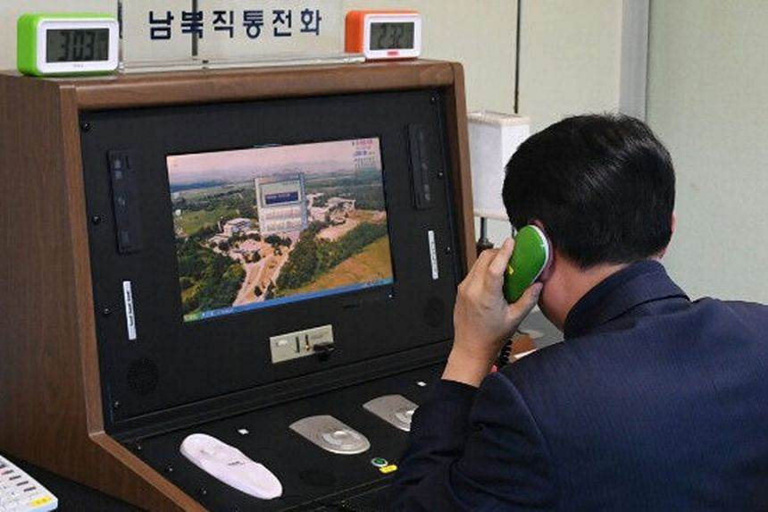 A South Korean official checks out a cross-border hotline at the liaison office in the Joint Security Area at the truce village of Panmunjom, South Korea on Jan 3, 2018.