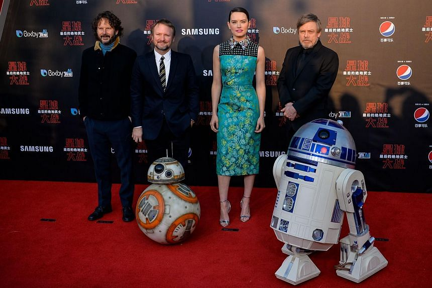 Daisy Ridley (second left) and Mark Hamill (second right), with droids BB-8 (left) and R2-D2 (right) pose on the red carpet for the Chinese premiere of Star Wars: The Last Jedi at the Shanghai Disney Resort on Dec 20, 2017.