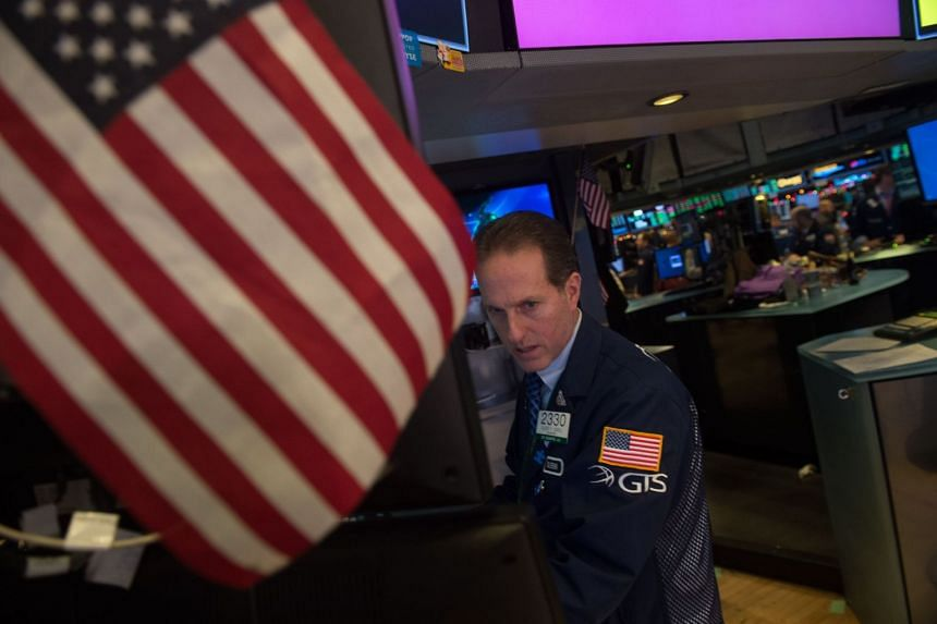 Traders work on the floor of the Dow Industrial Average at the New York Stock Exchange on Jan 2, 2018.
