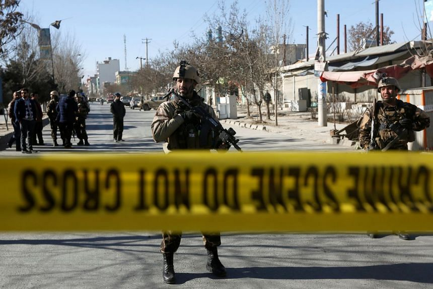 Afghan security forces keep watch at the site of a suicide attack in Kabul on Dec 28, 2017.