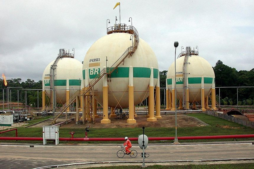 Petrobras' production facility in the Urucu oilfield near Coari, Brazil. With the settlement, the state-controlled oil giant will pay out more than six times what it has received so far under a Brazilian probe into bribery schemes.