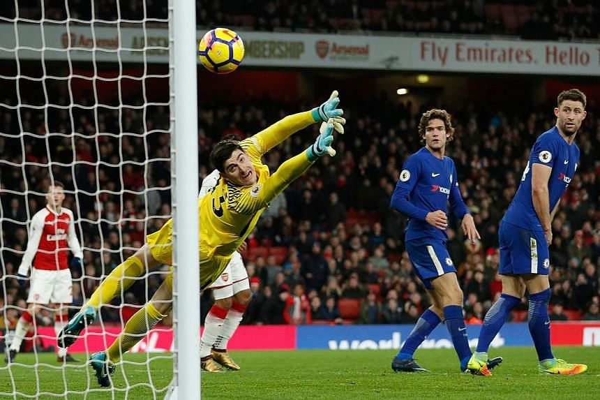 Arsenal's Hector Bellerin (not pictured) curling his shot past Chelsea goalkeeper Thibaut Courtois to equalise in stoppage time. Bellerin conceded a penalty in the 2-2 Premier League draw at the Emirates Stadium.