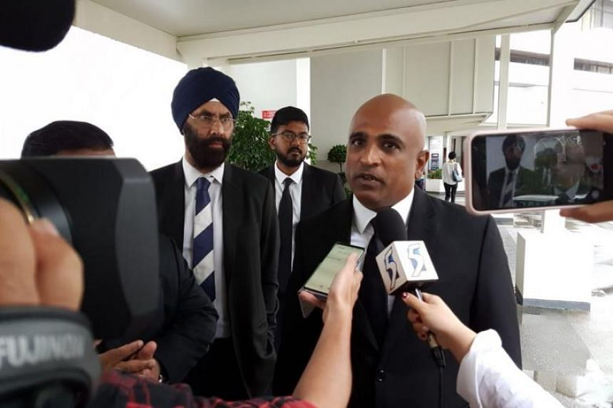 Lawyer and human rights activist M. Ravi speaking to the media after being sentenced to an 18-month mandatory treatment order for assaulting fellow lawyer and opposition politician Jeannette Chong-Aruldoss last year.