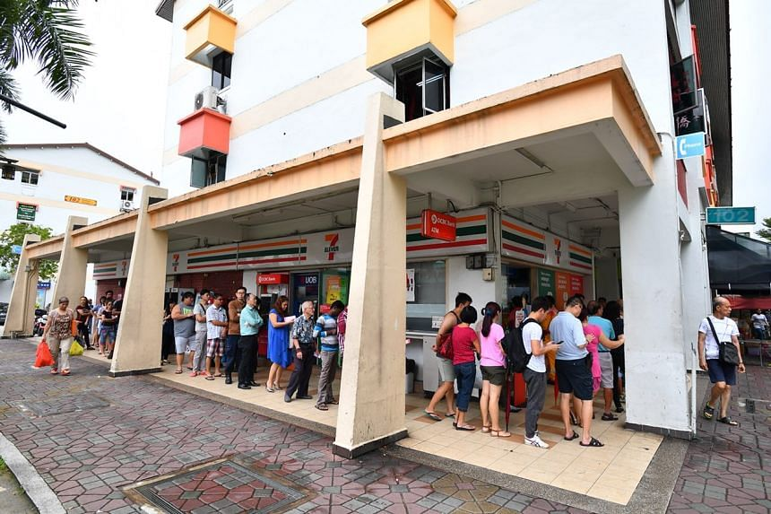 People queue to buy Toto at the 7-Eleven outlet at Blk 102 Yishun Ave 5 on Jan 5, 2018. The outlet is widely thought to be the luckiest in Singapore.