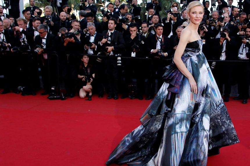 Cate Blanchett poses on the red carpet as she arrives for the screening of the film Carol in competition at the 68th Cannes Film Festival in Cannes, on May 17, 2015.