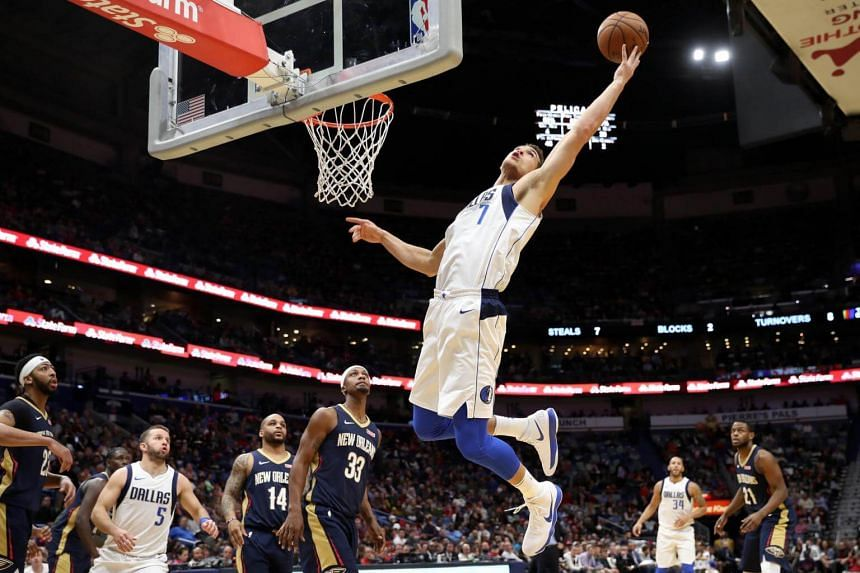 Dwight Powell of the Dallas Mavericks grabs a rebound against the New Orleans Pelicans at the Smoothie King Center in New Orleans on Dec 29, 2017.