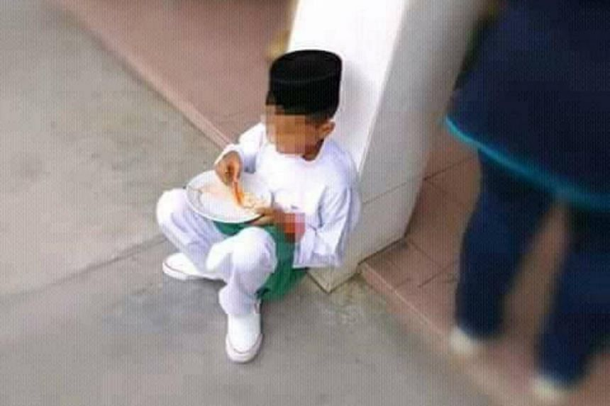 Teacher Mohd Fadli Salleh said that the lone student pictured may not have been the only one forced to eat his or her meal on the floor.