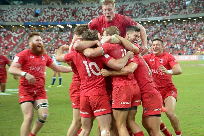 Canada players celebrate after emerging as surprise winners of the HSBC Singapore Rugby Sevens by beating the United States 26-19 in the final at the National Stadium on April 16, 2017.