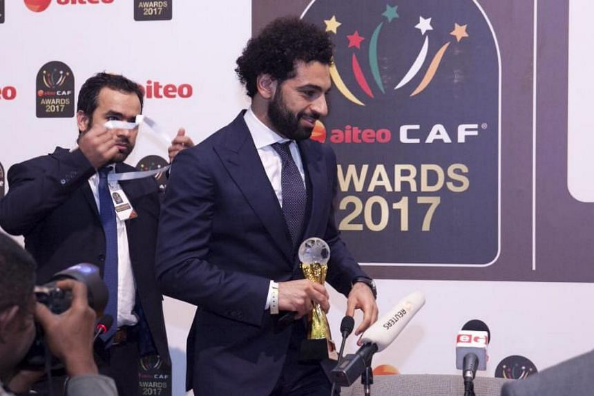 Egypt's Mohamed Salah receives the African Player of the Year award during the Confederation of African Football 2017 Awards ceremony in Accra, Ghana, on Jan 4, 2018.