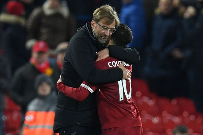 Klopp hugs Coutinho after Liverpool's match against Swansea City on Dec 26, 2017.