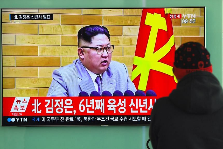 A television news broadcast shows North Korean leader Kim Jong Un's New Year's speech, at a railway station in Seoul on Jan 1, 2018.