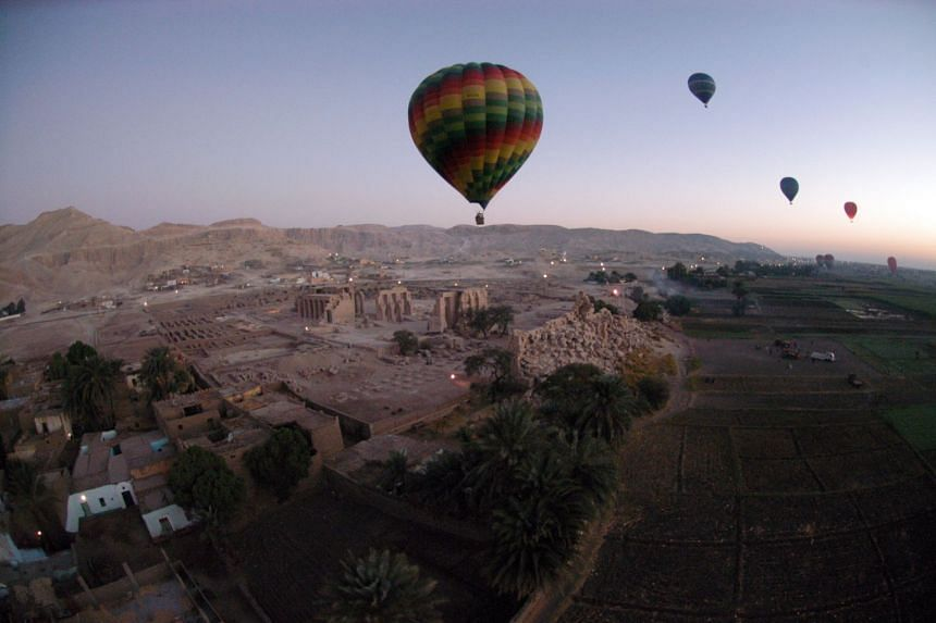 Tourist hot air balloons are seen floating across Egypt's Valley of the Kings in 2007. A hot air balloon carrying 20 people, including tourists, crashed near the city of  Luxor on Jan 5.