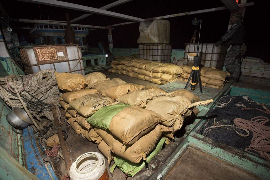 Parcels of seized narcotics on the deck of a smuggling vessel as HMAS Warramunga's boarding team conduct an illicit cargo seizure during operations in the Arabian Sea.