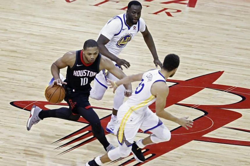 Golden State Warriors players Stephen Curry (right) and Draymond Green (centre) go after Houston Rockets guard Eric Gordon (left) during the NBA game between the Warriors and Rockets in Houston, Texas on Jan 4, 2018.