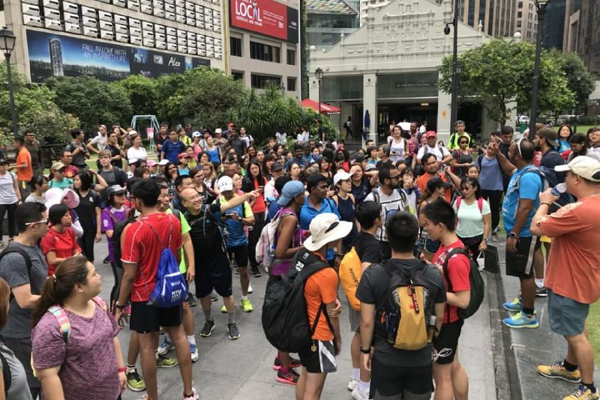 More than 150 people prepare to walk around Singapore, at Raffles Place, the designated starting point.