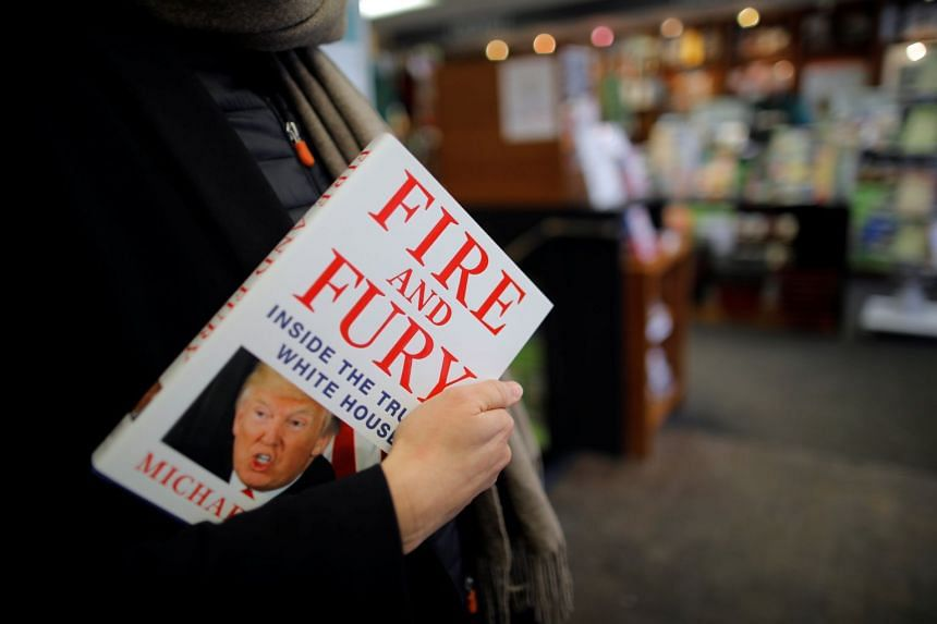 A woman holds a copy of the book at a book store in Washington, DC, Jan 5, 2018.