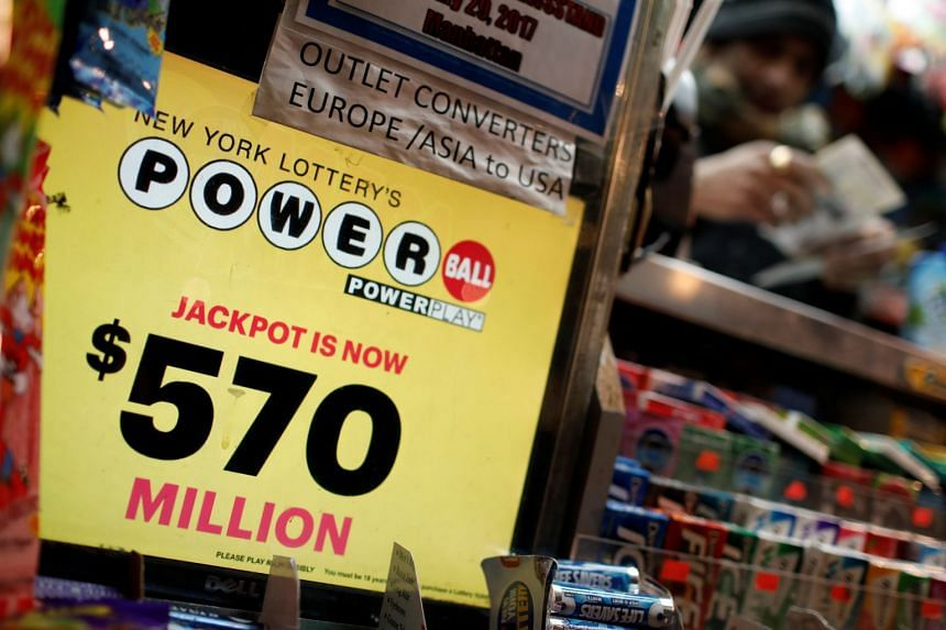 A vendor sells lottery tickets for the Powerball and Mega Millions draw at a news stand in midtown Manhattan.
