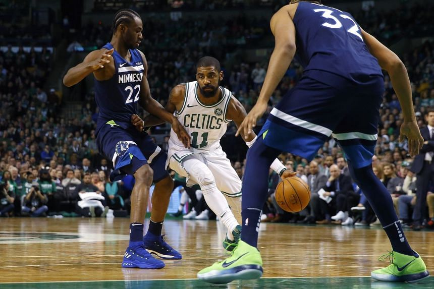 99dc15d73 Boston Celtics guard Kyrie Irving driving past Minnesota Timberwolves  forward Andrew Wiggins (left) during