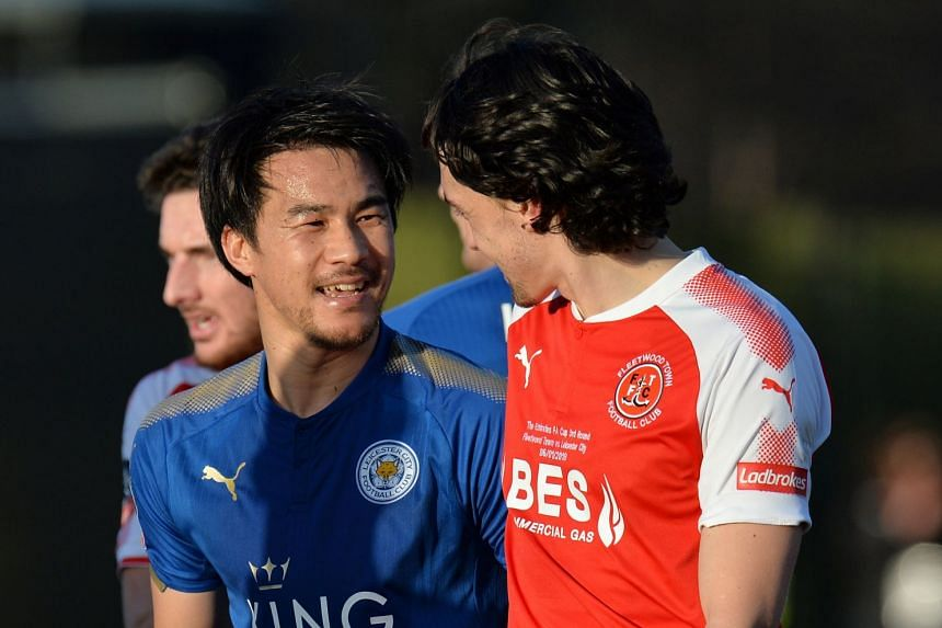 Leicester City's Shinji Okazaki with Fleetwood Town's Markus Schwabl after the match.