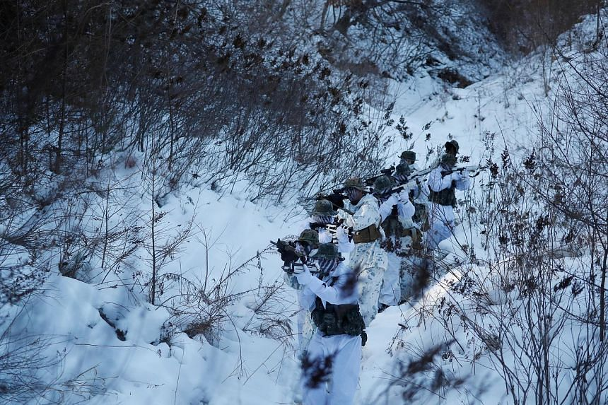 South Korean and US Marines taking part in a winter military drill in Pyeongchang, South Korea, last month. The two countries have agreed to delay the giant Foal Eagle and Key Resolve joint military drills until after the Winter Olympics, which begin