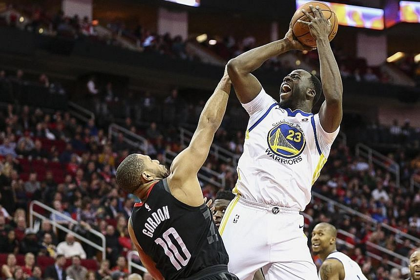 Golden State forward Draymond Green shooting over the defence of Houston guard Eric Gordon during the Warriors' dominant fourth quarter in which they held the lead throughout. Golden State avenged their opening-night loss to their Western Conference