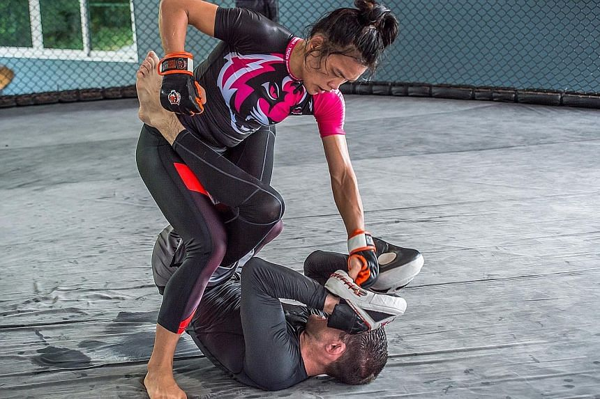 Singapore's Tiffany Teo (left) during a technical training session at the Tiger Muay Thai & MMA Gym in Phuket, Thailand. She is based there, training for her One Championship strawweight title bout with China's Xiong Jingnan (below) on Jan 20.
