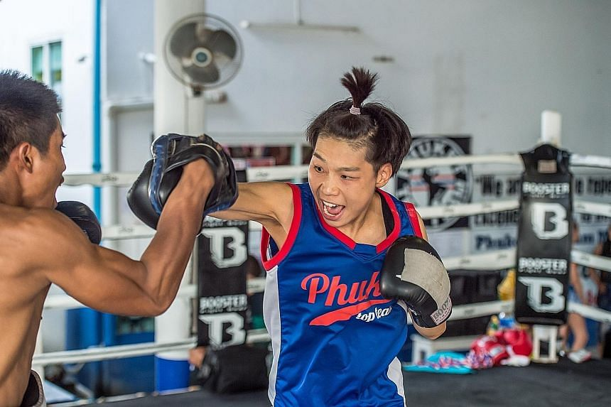 Singapore's Tiffany Teo during a technical training session at the Tiger Muay Thai & MMA Gym in Phuket, Thailand. She is based there, training for her One Championship strawweight title bout with China's Xiong Jingnan (above) on Jan 20.