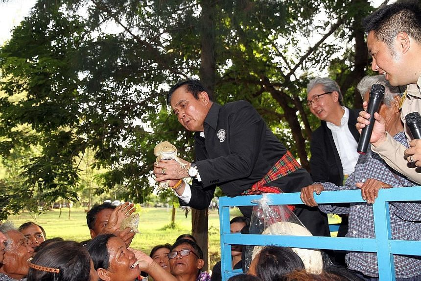 Thai Prime Minister Prayut Chan-o-cha on a tour to promote the junta's efforts in the northern Thai province of Nakhon Ratchasima last August. His government got an average approval score of 5.73, out of 10, in the latest survey.