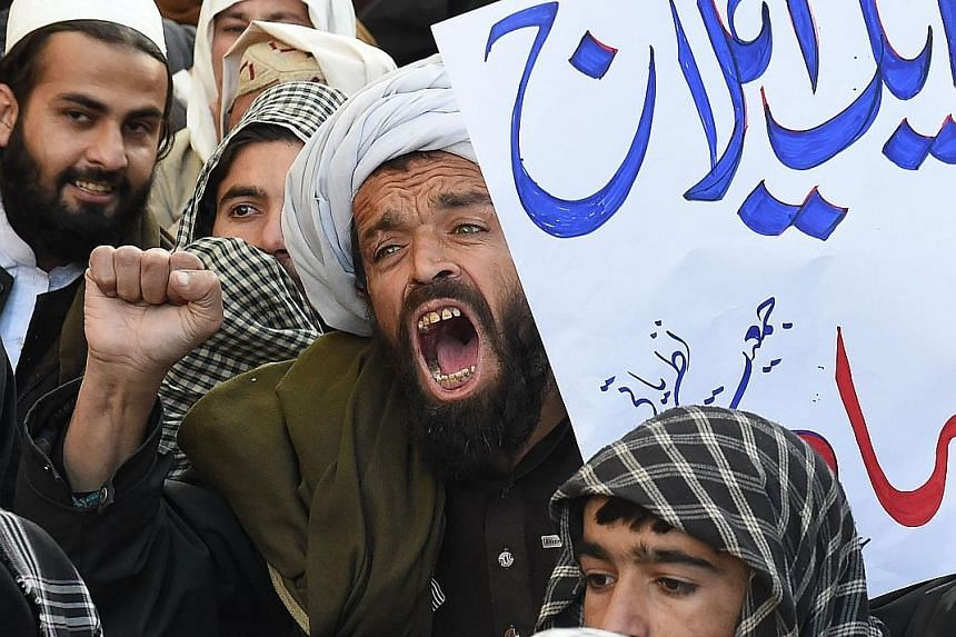 Pakistani demonstrators shouting anti-US slogans and burning the US flag during a protest in Quetta on Thursday after the Trump administration threatened to cut off aid to Pakistan.