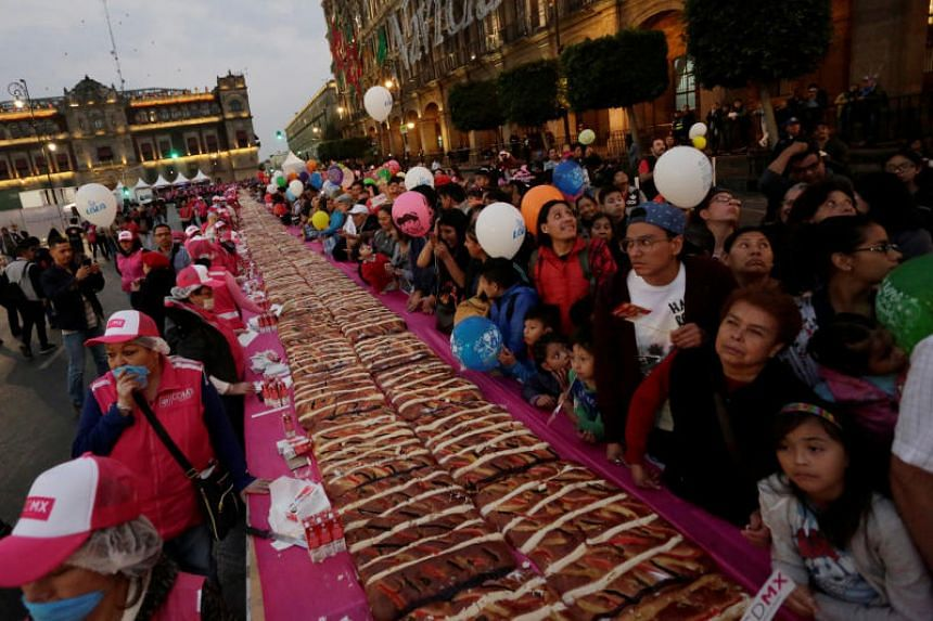 "Some 250,000 people turned out to the main plaza to devour the cake known as ""Rosca de Reyes""."