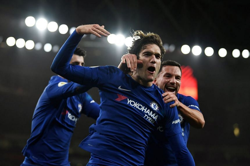 Chelsea's Marcos Alonso celebrates after scoring a goal during an English Premier League football match against Arsenal.