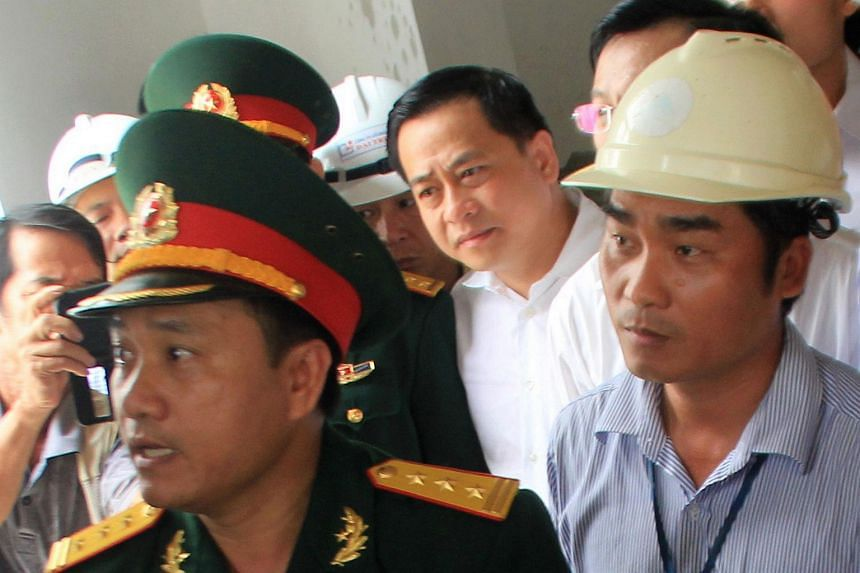 The case that drew most recent controversy involves Phan Van Anh Vu (centre), a property tycoon from the central city of Danang accused of revealing state secrets.