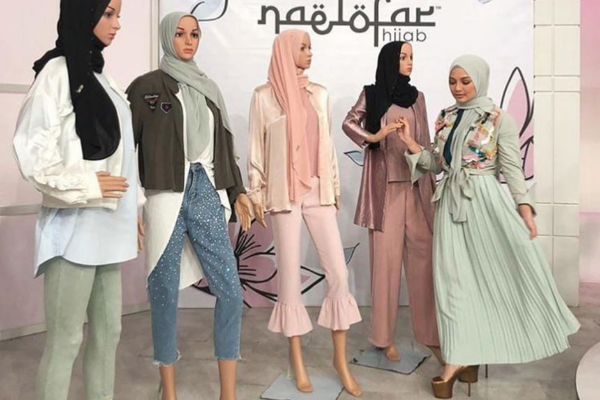 Malaysian actress and model Noor Neelofa Mohd Noor showcasing headscarves from her label Naelofar Hijab's new collection.