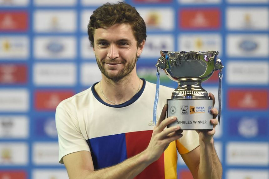 Gilles Simon poses with the men's singles winners trophy.