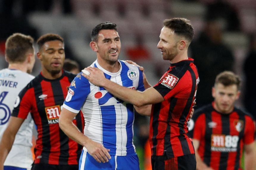 Bournemouth's Marc Pugh with Wigan Athletic's Gary Roberts after the match.