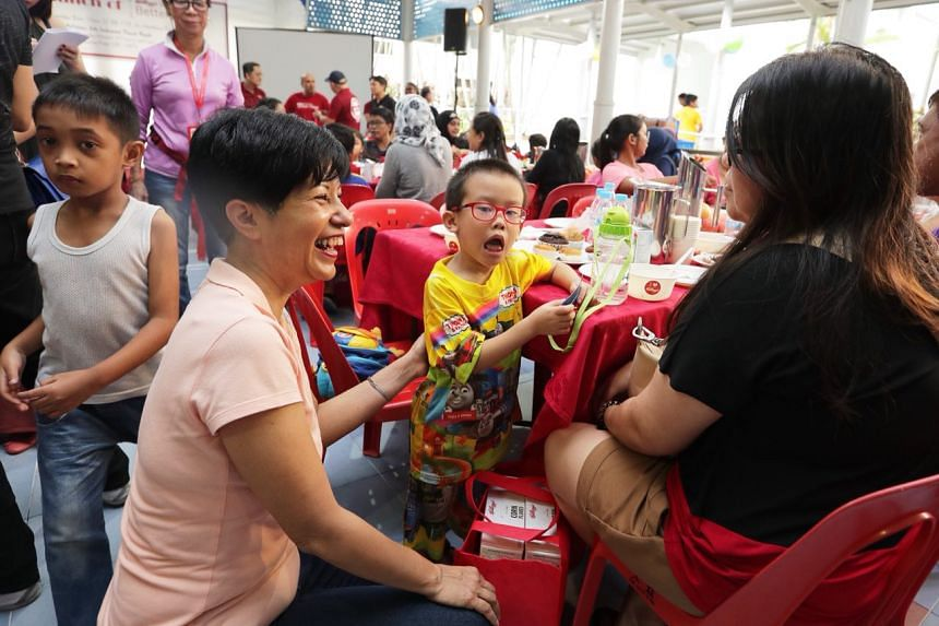 Ms Indranee Rajah, Senior Minister of State for Law and Finance, chatting with Garvin Wong and his mum Sabrina Wong.