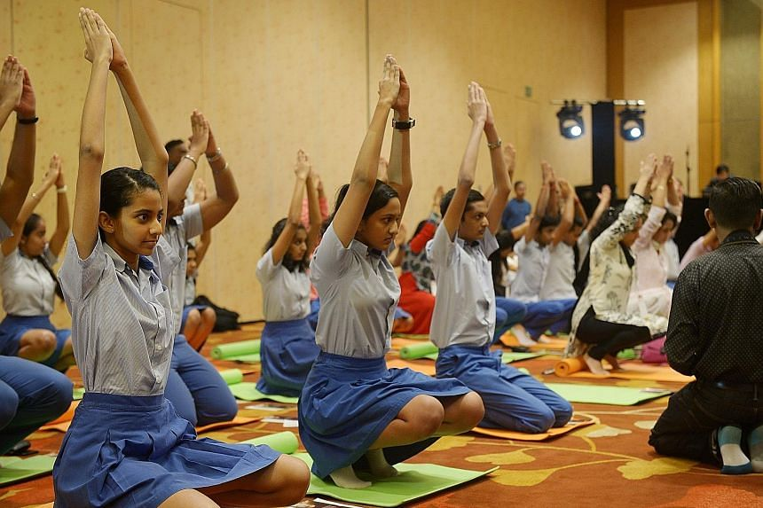 Students from the Global Indian International School doing Yoga Namaskar, a form of Upa Yoga taught by the Isha Yoga school. This was one of the events on the sidelines of the Asean-India Convention at the Marina Bay Sands Convention Centre yesterday