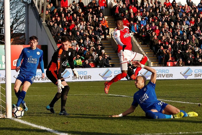 Leicester City goalkeeper Eldin Jakupovic is rooted to the spot as a shot from Fleetwood Town's Ashley Hunter (not in picture) is deflected onto the foot of the post while his defenders Yohan Benalouane, Ben Chilwell and Fleetwood striker Devante Col