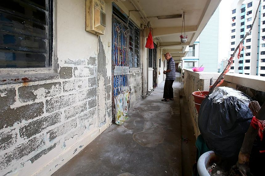 At Block 55, Lorong 5 Toa Payoh, where a woman was reportedly shouting loudly every morning. The walls outside her unit (left) were peeling, with bare bricks exposed at certain spots. The metal pipes were corroded and the floor looked pitted.