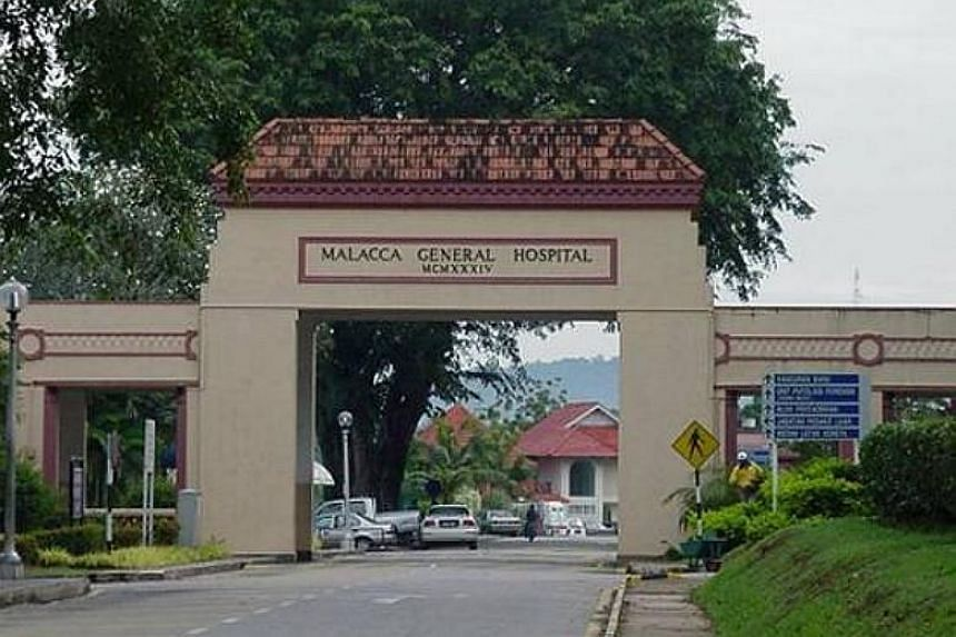 An eight-year-old boy sustained serious head injuries after being knocked down by a car and dragged about 15m inside a primary school compound in Malacca.