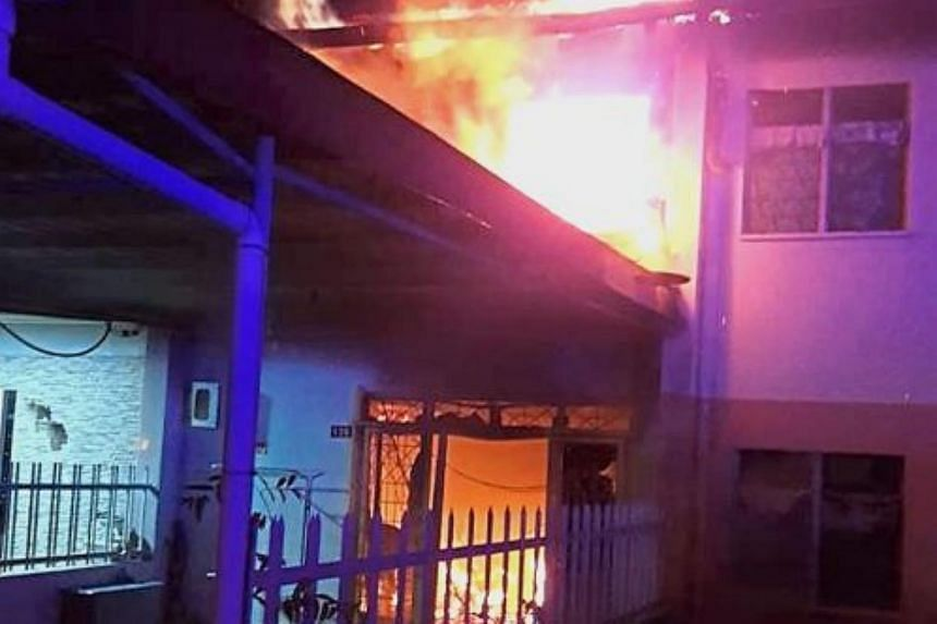 The fire burning out of control at the ill-fated house in Tenom, near Kota Kinabalu.