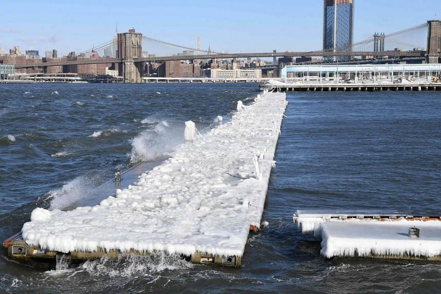 A pier covered in snow and ice floats in the East River in Brooklyn, New York, on Jan 5, 2018.