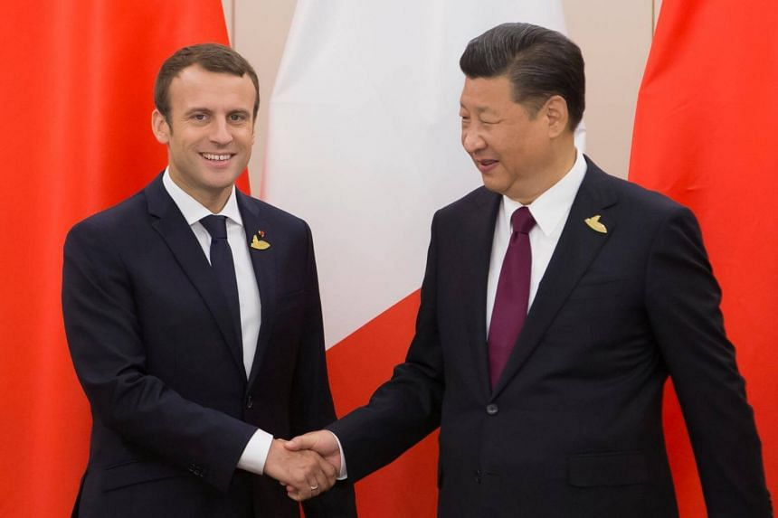 French President Emmanuel Macron (left) shakes hands with Chinese President Xi Jinping during a bilateral meeting on the second day of the G20 summit in Hamburg, Germany on July 8, 2017.